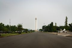Monas, the National Monument, in central Jakarta. Jakarta, Indonesia - November 2017: View of Monas, the National Monument, in central Jakarta on a cloudy smog royalty free stock images