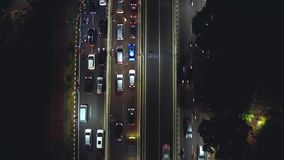 Night traffic jam with vehicles moving slowly stock video