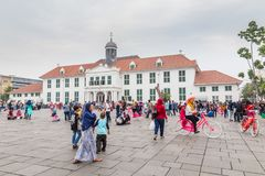 Bicycle and hats rental in the old city of Jakarta, Indonesia,. Jakarta, Indonesia - October, 28, 2017 Recreation on Fatahillah Square, Kota Tua. old city of royalty free stock photography