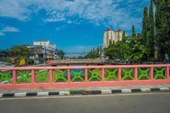 JAKARTA, INDONESIA: View from small bridge showing some residence buildings in distance, beautiful blue sky.  stock photo
