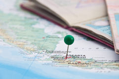 Jakarta, Java, Indonesia, GreenPin and Passport, Close-Up of Map. Macro of Green Pin on Map, Jakarta, Java, Indonesia, Passport, Close-Up of Map royalty free stock image