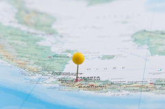 Jakarta, Java, Indonesia, Yellow Pin, Close-Up of Map. Macro of a Yellow Pin on Map, Jakarta, Java, Indonesia, Close-Up of Map royalty free stock images