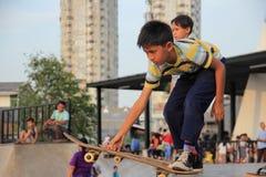JAKARTA - May 27th, 2017. Kids playing skateboard on Kalijodo, J stock photo