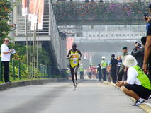 Jakarta - October 27, 2013 Kipkemboi Chelimo Kenya. Runner at Jakarta Marathon finish 3rd place with time 2 hours 26 minutes royalty free stock image