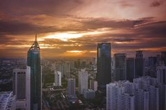 Jakarta office buildings in Sudirman at dawn time. JAKARTA - Indonesia. February 18, 2019: Aerial view of Jakarta office buildings in Sudirman Central Business stock image