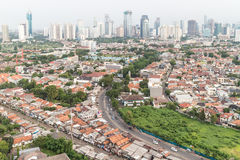 Jakarta skyline. Residential area right in the center of Jakarta, the capital city of Indonesia. The city is still composed of lots of villages, or Kampung, in royalty free stock images
