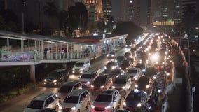 Jakarta stad med fullsatta bilar på trafikstockning arkivfilmer