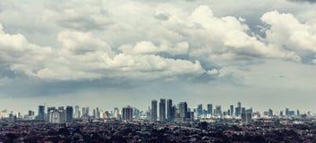 Jakarta stadssikt med Kampung Fotografering för Bildbyråer