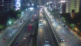 Jakarta tollway at night with moving vehicles stock video
