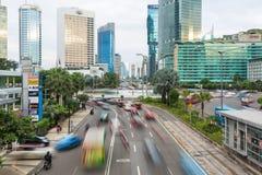 Jakarta trafik runt om plazaen Indonesien Royaltyfria Bilder