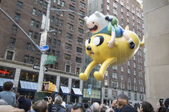 Jake and Finn, from Adventure time, Balloon in 89th annual Macy's Parade. NEW YORK CITY, NY - NOVEMBER 26: Jake and Finn, from Adventure time, balloon in city Stock Photo