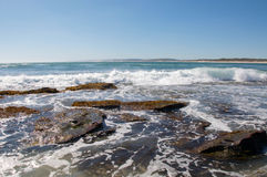 Jake's Point Seascape in Kalbarri. Rocky Indian Ocean coast line at Jake's Point beach with Turquoise Indian Ocean waves under clear skies on the coral coast in Royalty Free Stock Images