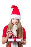 jako ubierający prezenta otwarcia Santa kobiety xmas Obrazy Royalty Free
