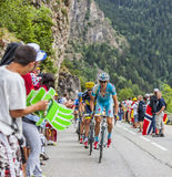 Jakob Fuglsang Climbing Alpe D'Huez. Alpe-D'Huez,France- July 18, 2013: The Danish cyclist Jakob Fuglsang from Astana Team climbing the difficult road to Alpe-D' Stock Images