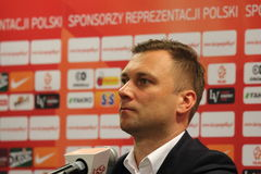 Jakub Kwiatkowski. WARSAW, POLAND - OCTOBER 13, 2014: Jakub Kwiatkowski, press officer of the Polish national football team attends a press conference before the Royalty Free Stock Image