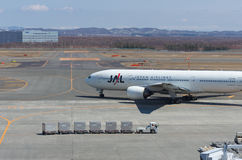 JAL Boeing 777 on a taxiway Royalty Free Stock Images