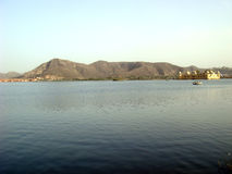 Jal Mahal and mountain view. Scenic view of Jal Mahal and mountains royalty free stock photos