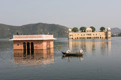 Jal Mahal Palace and Aravalli Hills. Jal Mahal on the Man Sagar lake in Jaipur, Rajasthan. Built infusing Mughal and Rajput architecture, this palace looks Royalty Free Stock Image