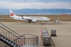JAL plane on the tarmac. A Japan Airlines plane towed onto the tarmac ready for take off Royalty Free Stock Photo