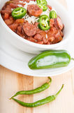 Jalapeno and Cayenne Peppers with Bowl of Red Beans Stock Photos