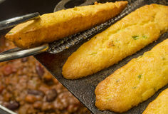 Jalapeno cornbread freshly baked. In a cast iron corn cob mold being served royalty free stock photography