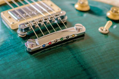 Jalapeno green electric guitar maple top body close up view with bridge, tone knobs and pickup switch. Jalapeno green electric guitar maple top body close up Royalty Free Stock Image