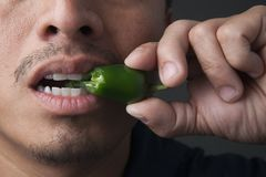 Jalapeno pepper bite Stock Photos