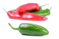 Jalapeno Peppers. Green and Red Jalapeno Peppers with Soft Shadows Against a White Background Royalty Free Stock Photography