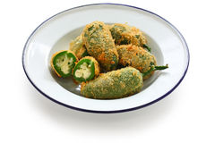 Jalapeno poppers. Jalapeno stuffed with cheese on a white background royalty free stock photos