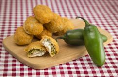 Jalapeno Poppers on a Red Gingham Tablecloth. Plate of Jalapeno Poppers on a Red Gingham Tablecloth royalty free stock photography