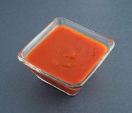 Jalapeno salsa sauce in square bowl Stock Image