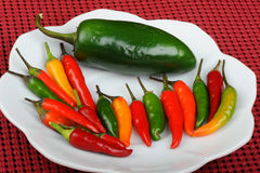 Jalapeno and Thai peppers Stock Photos