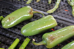 Jalapenos on a barbecue grill Royalty Free Stock Images