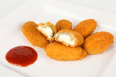 Jalapenos filled with cream cheese. And sauce Stock Image