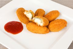 Jalapenos filled with cream cheese. And sauce Stock Photo