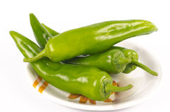 Jalapenos (Green Chilies). Green chilli peppers (Jalapenos) placed in a saucer on white background Stock Photos