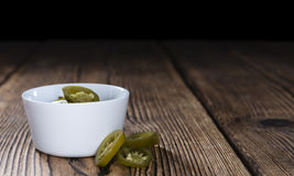 Jalapenos on wooden background Stock Photos