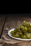 Jalapenos on wooden background Stock Photography