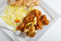 Jalfrezi and rice. Chicken jalfrezi curry on a plate with pilau rice and a piece of naan bread seen from above Royalty Free Stock Photo