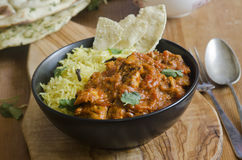 Jalfrezi with rice. Jalfrezi Indian chicken curry with pilau rice and pappadom Stock Photography
