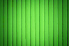 Jalousies. Green jalousies having a cloth foundation with spot of light. Can be used as background Royalty Free Stock Images