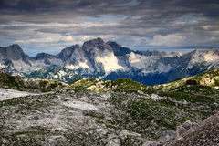 Jalovec and Mangart peaks in a sunny morning, Julian Alps. Jalovec and Mangart peaks Julian Alps, Triglav National Park, Slovenia in a partly sunny morning, in Stock Photo