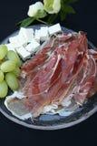 Jamón de Prosciutto, fromage y uvas Foto de archivo libre de regalías