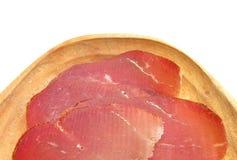 Jamón del crudo de Prosciutto aislado en el fondo blanco Imagen de archivo