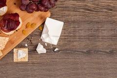 Jamón italiano con las galletas con el queso blanco Fotografía de archivo libre de regalías