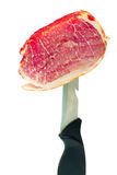 Jamón sobre un fondo blanco. Stock Photos
