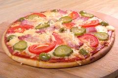 Jamón y vehículo de la pizza Imagenes de archivo