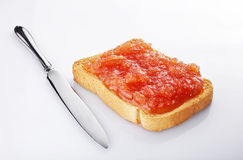 Jam. Slice of bread covered with jam stock image