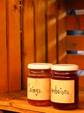 Jam. Two bottles of jam marmalade and strawberry stock images