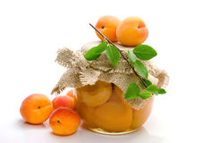 Jam of apricots  on white background. Royalty Free Stock Photos